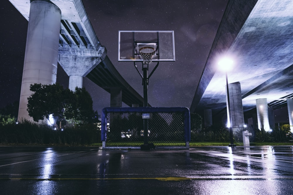 photography of empty wet basketball court