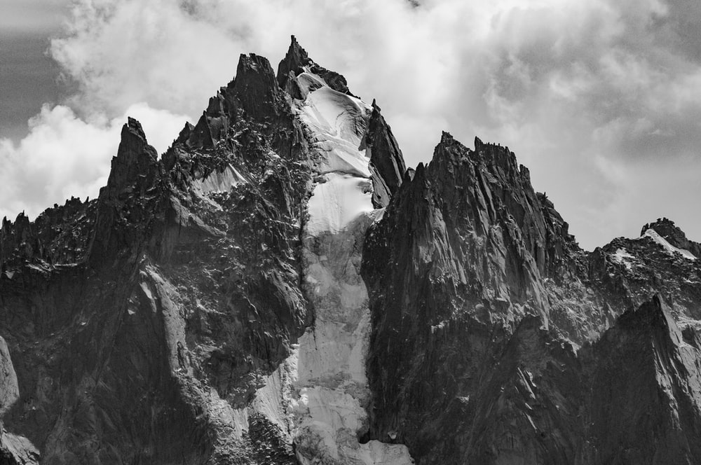 rock formation under clouds