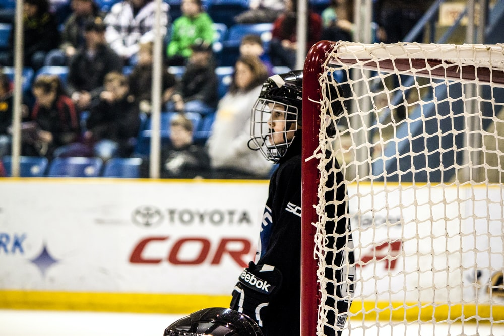 ice hockey player near goal net