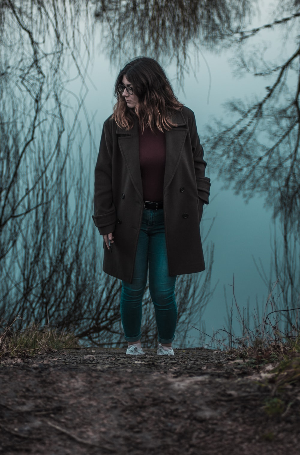 woman walking near withered plants