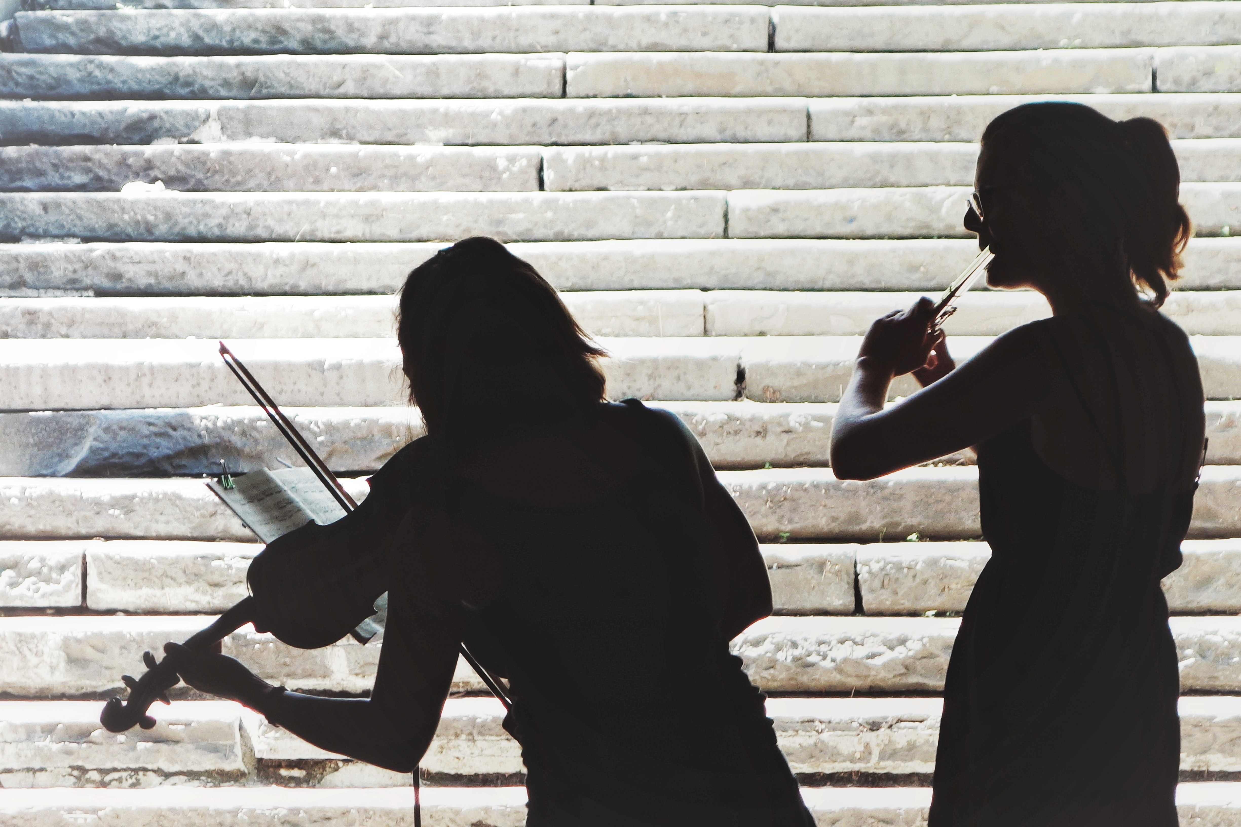 two women playing violin and flute