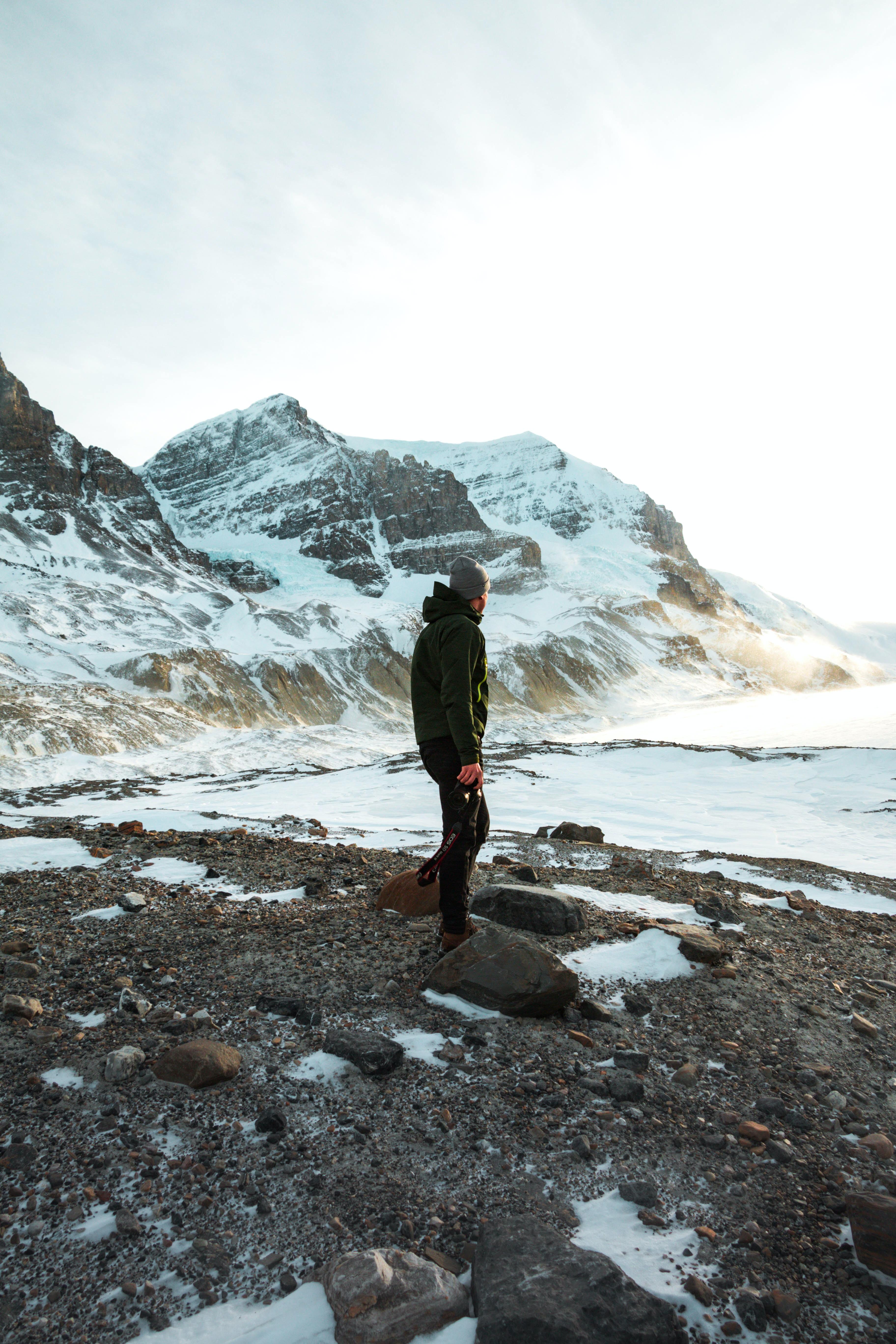 man standing near mountain