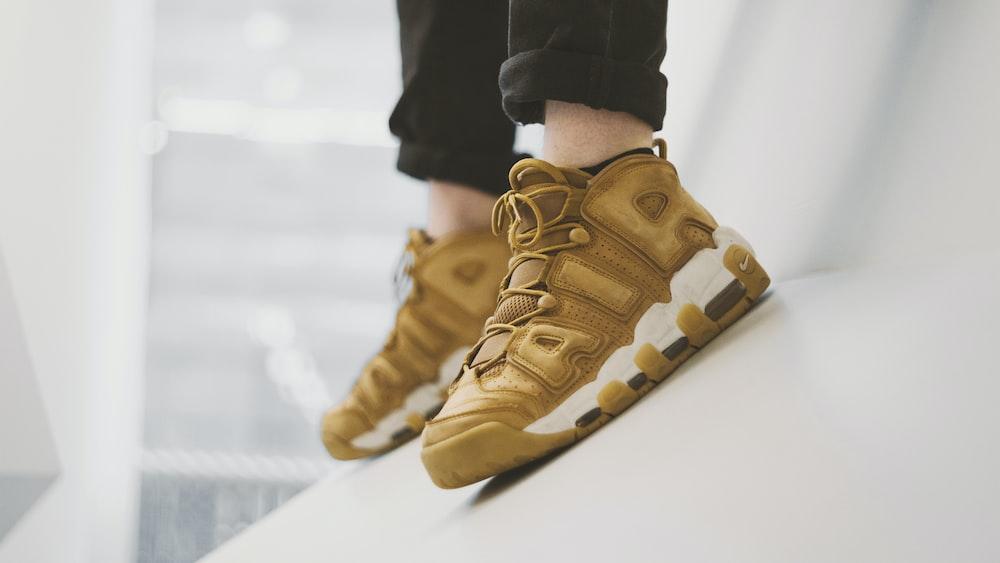 pair of brown Nike Air shoes