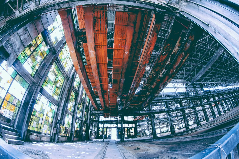 fish lens photography of black and red building interior