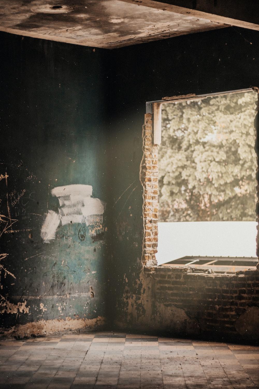 brown concrete brick room during daytime