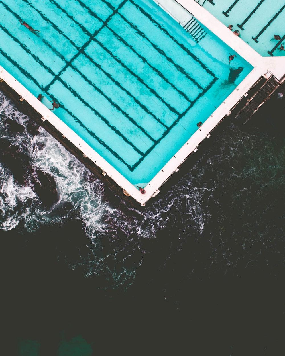 aerial photo of pool near beach