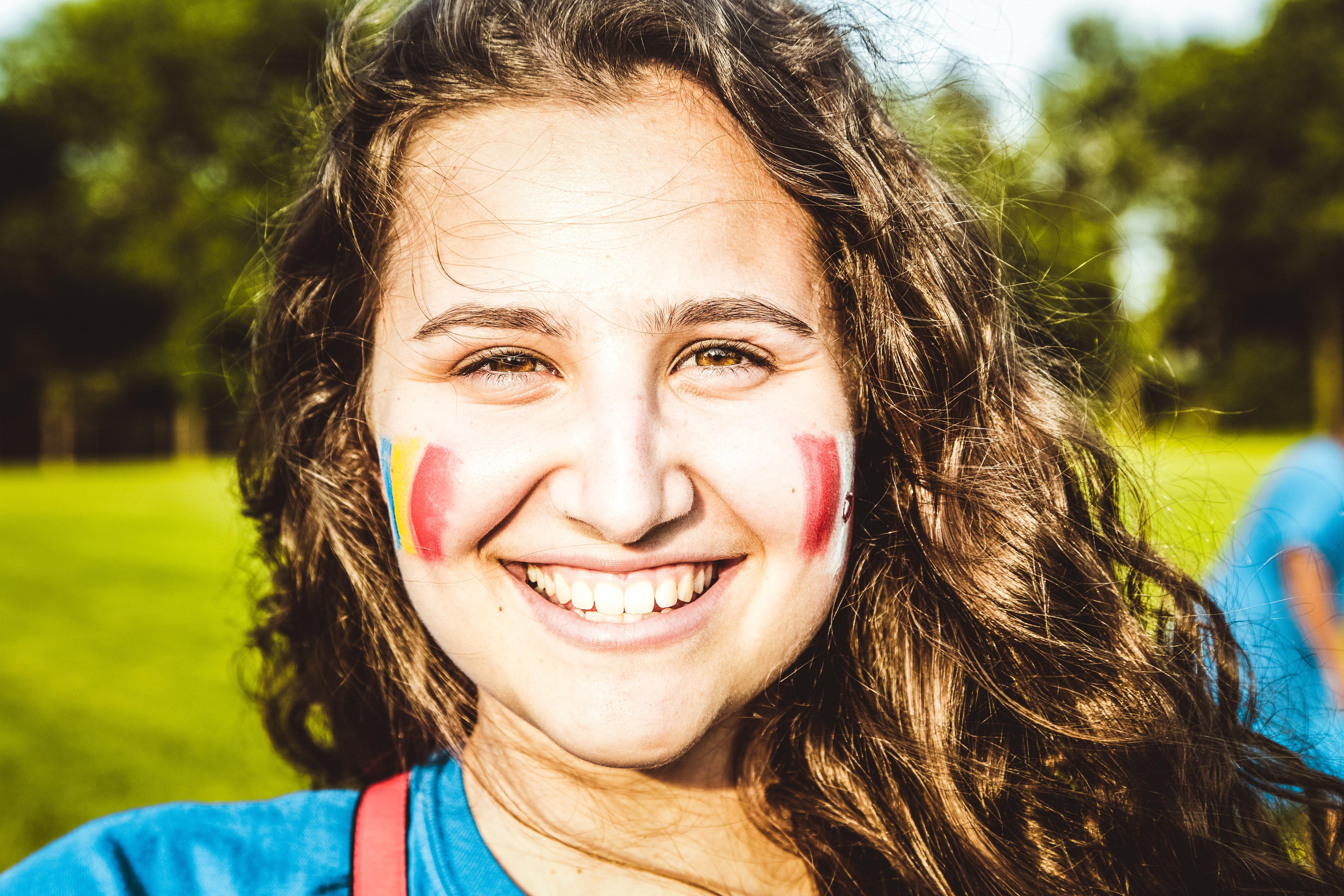 smiling woman closeup photography