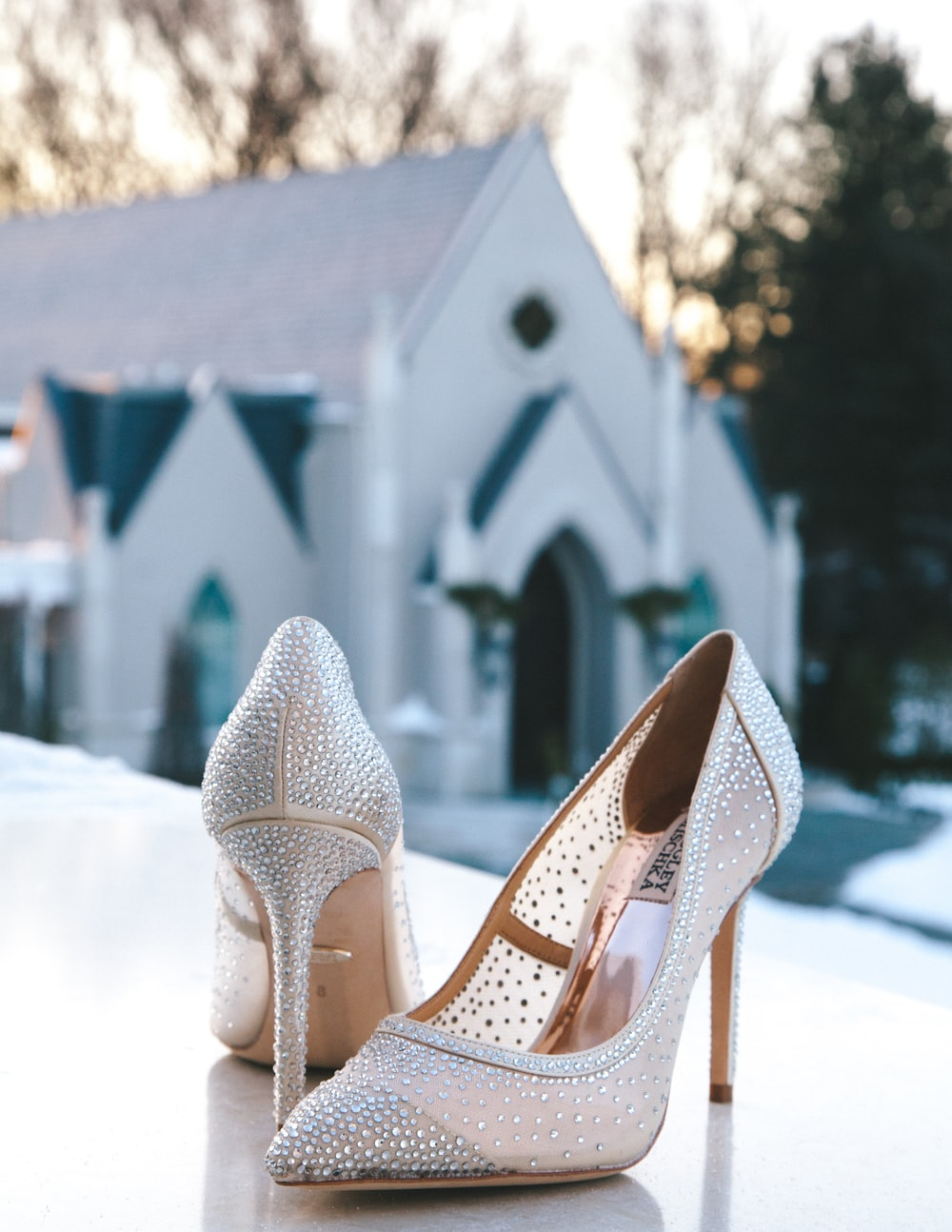 pair of glitter white pointed-toe pumps