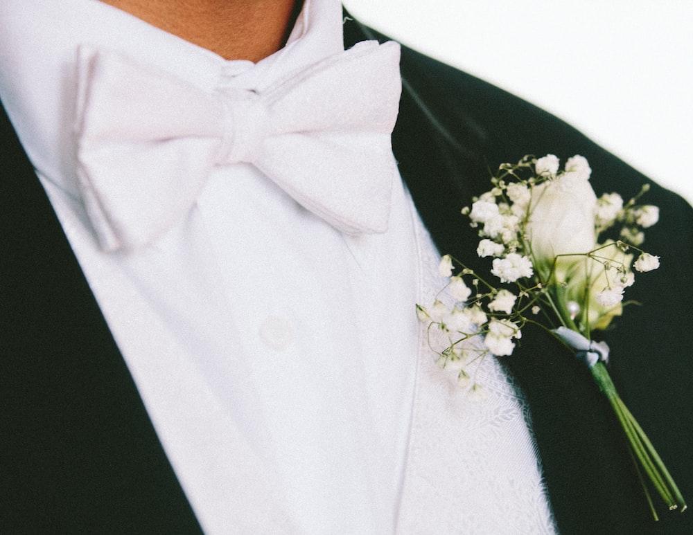 white petaled flower on man's lapel