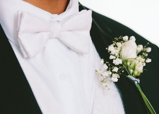 white petaled flower on man's lapel