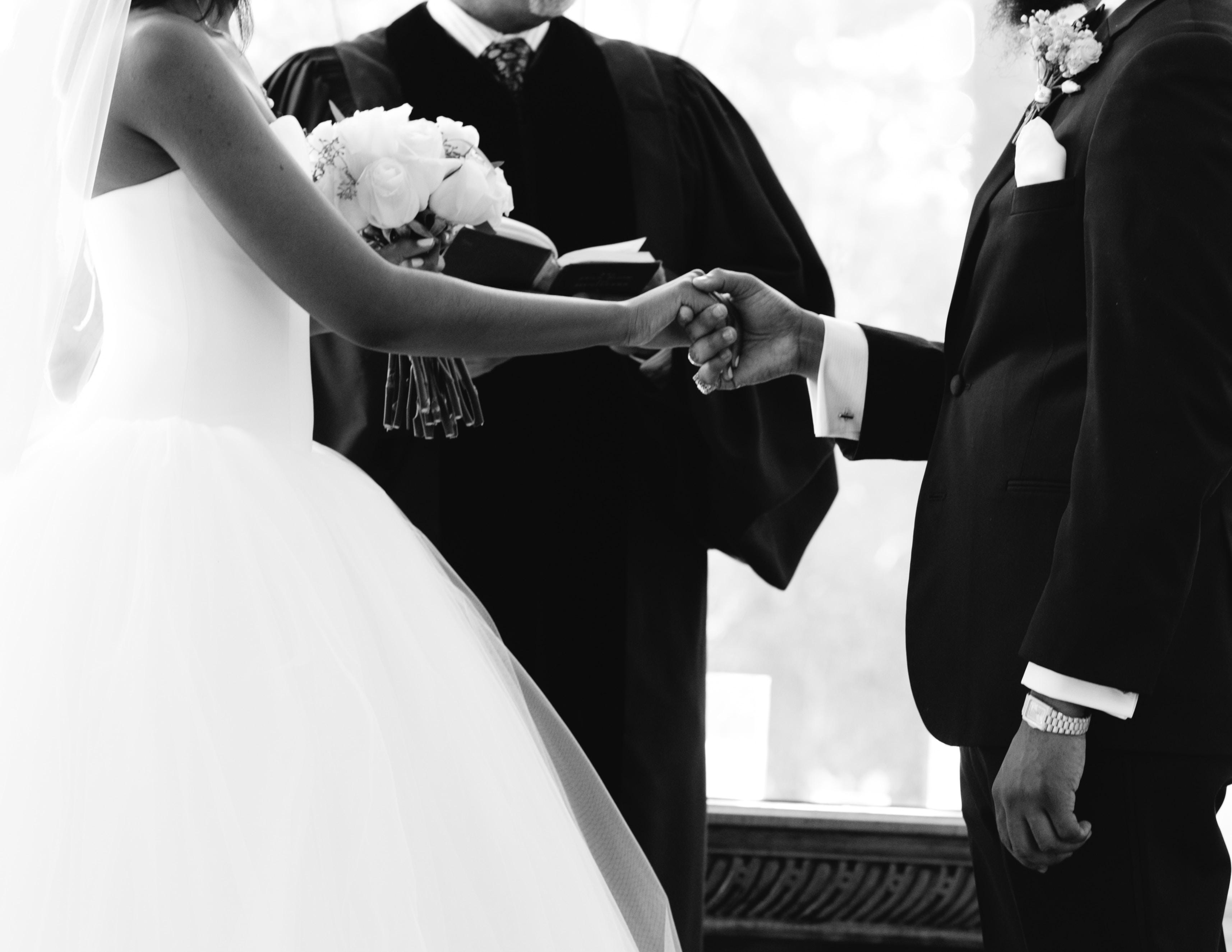 grayscale photography of newlywed couple
