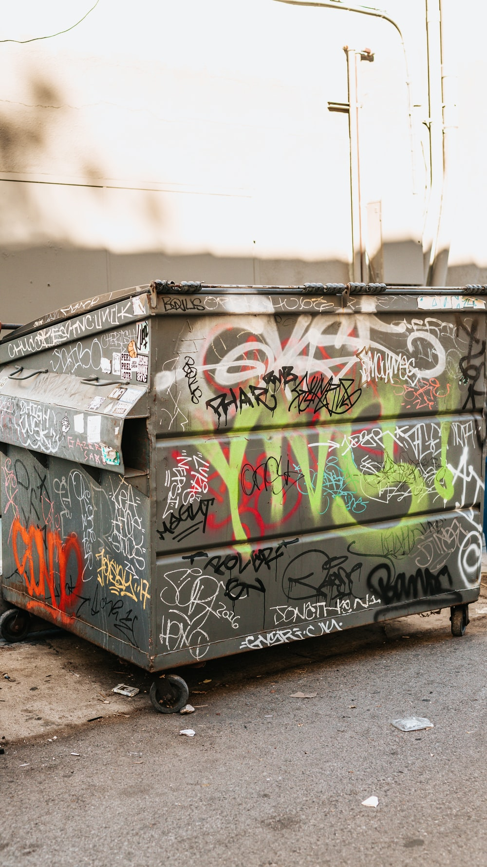 gray and white trash bin with paintings