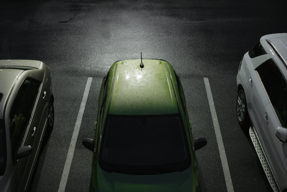 green car parked on the street