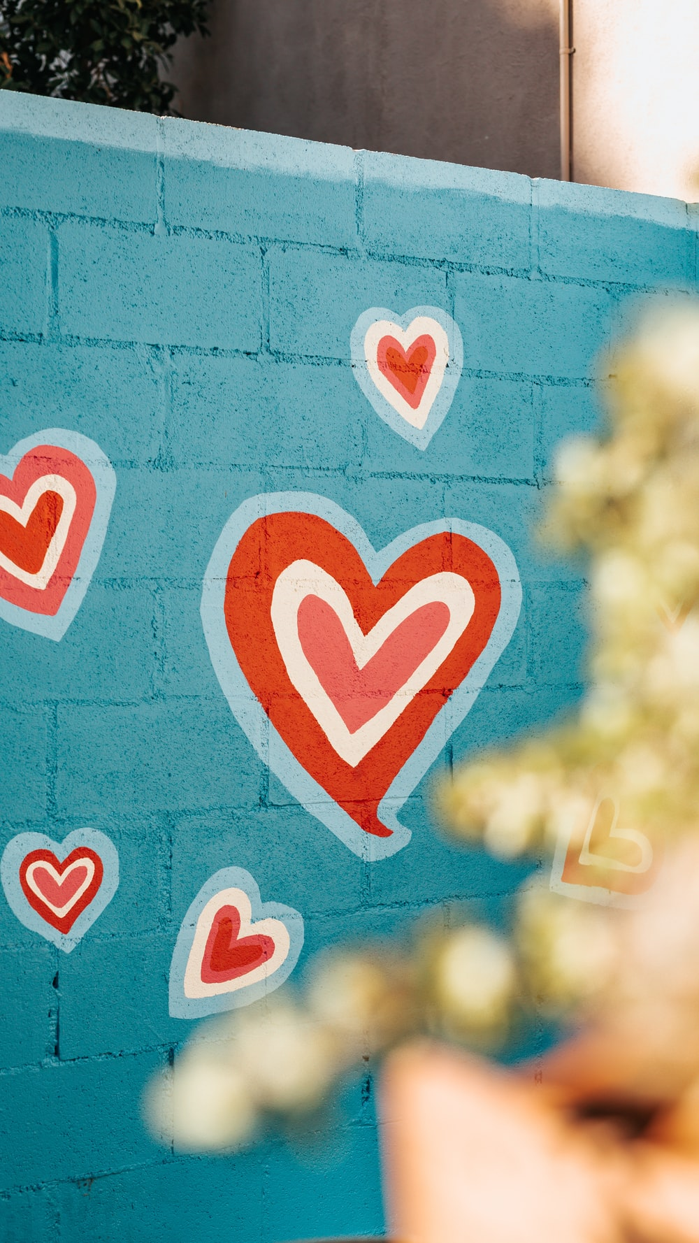 selective photo of red and white hearts graffiti