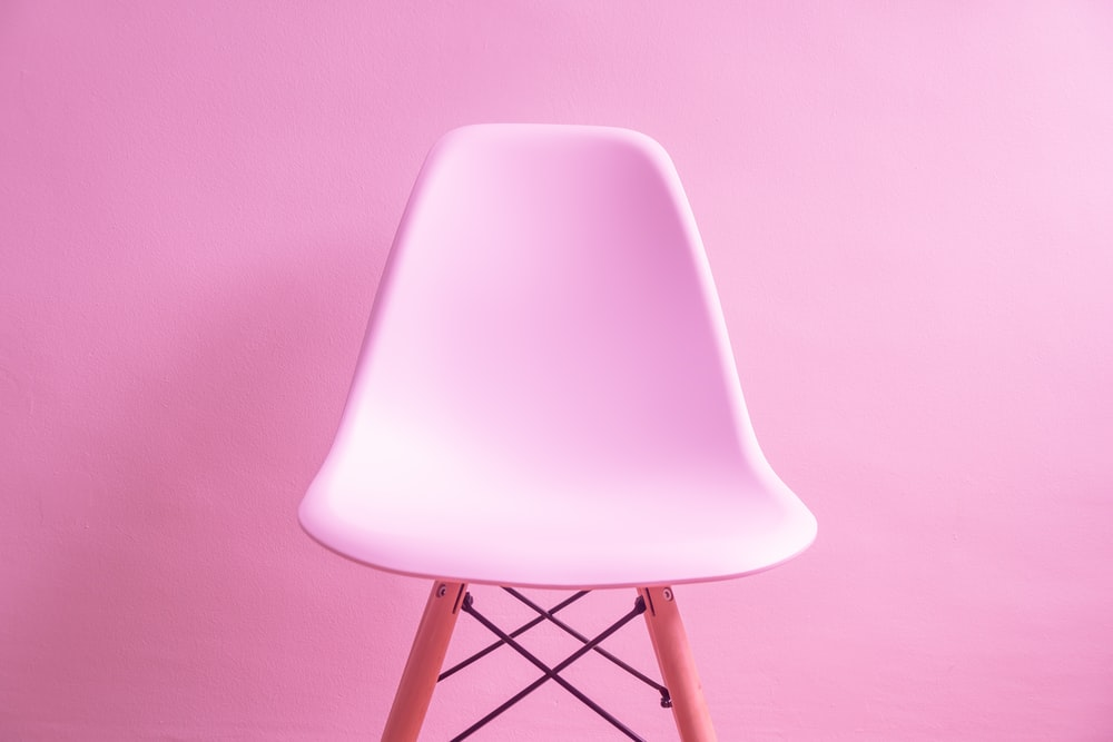 photo of pink chair with pink background