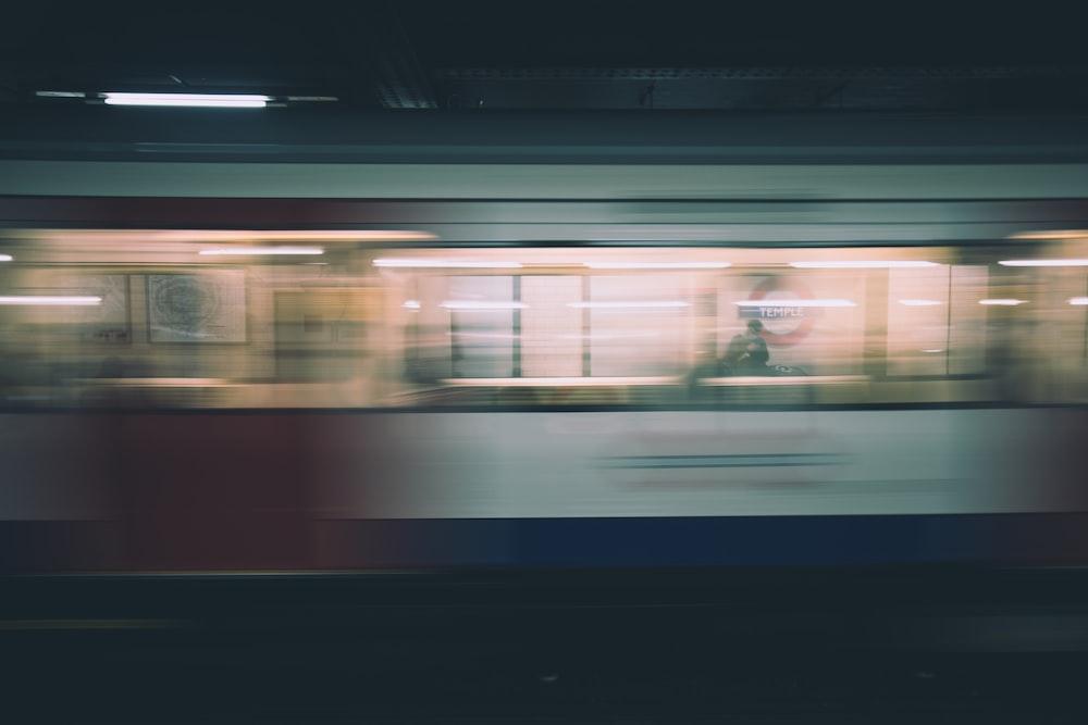 time lapse photo of speeding train