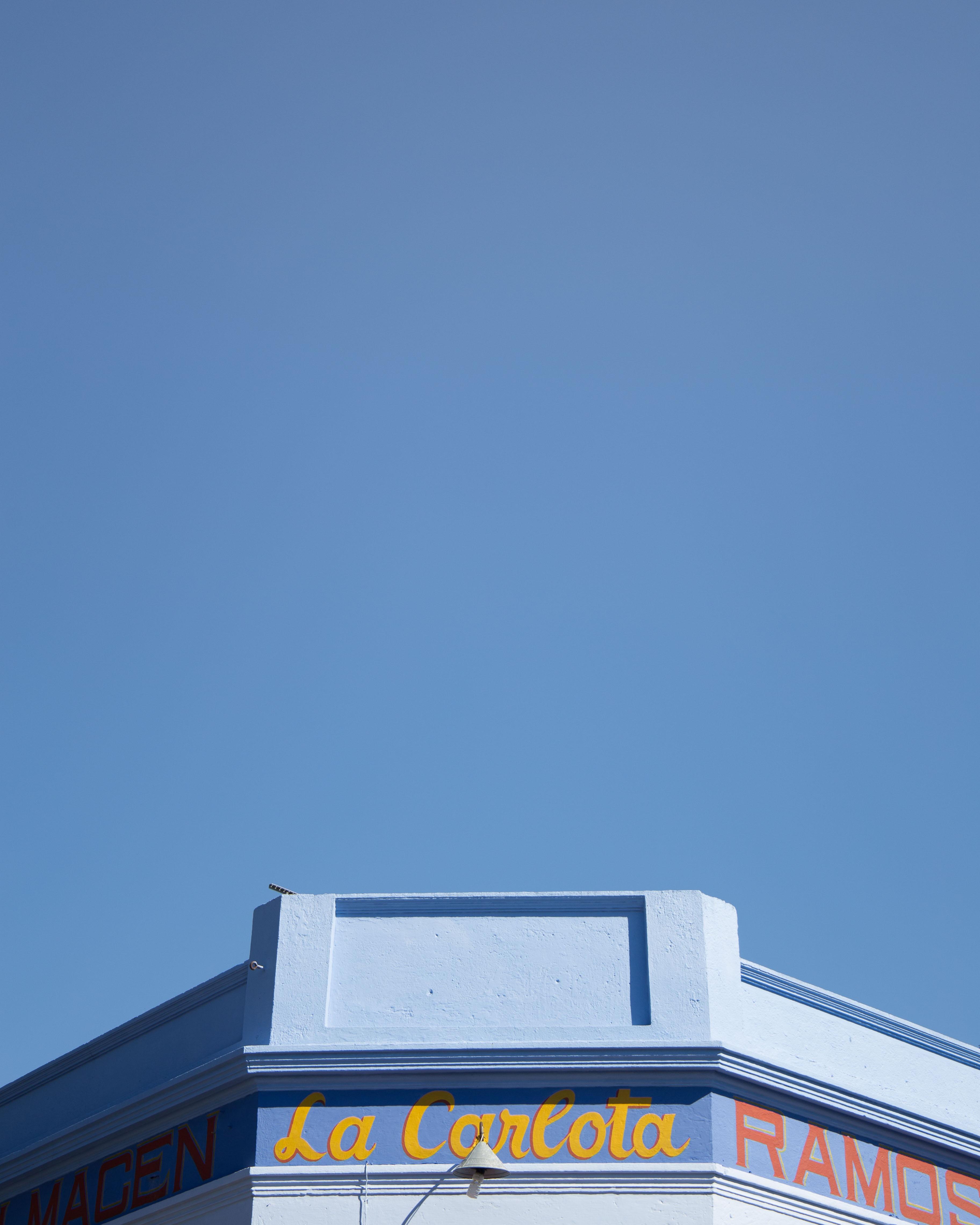 La Carlota building under blue sky during daytime