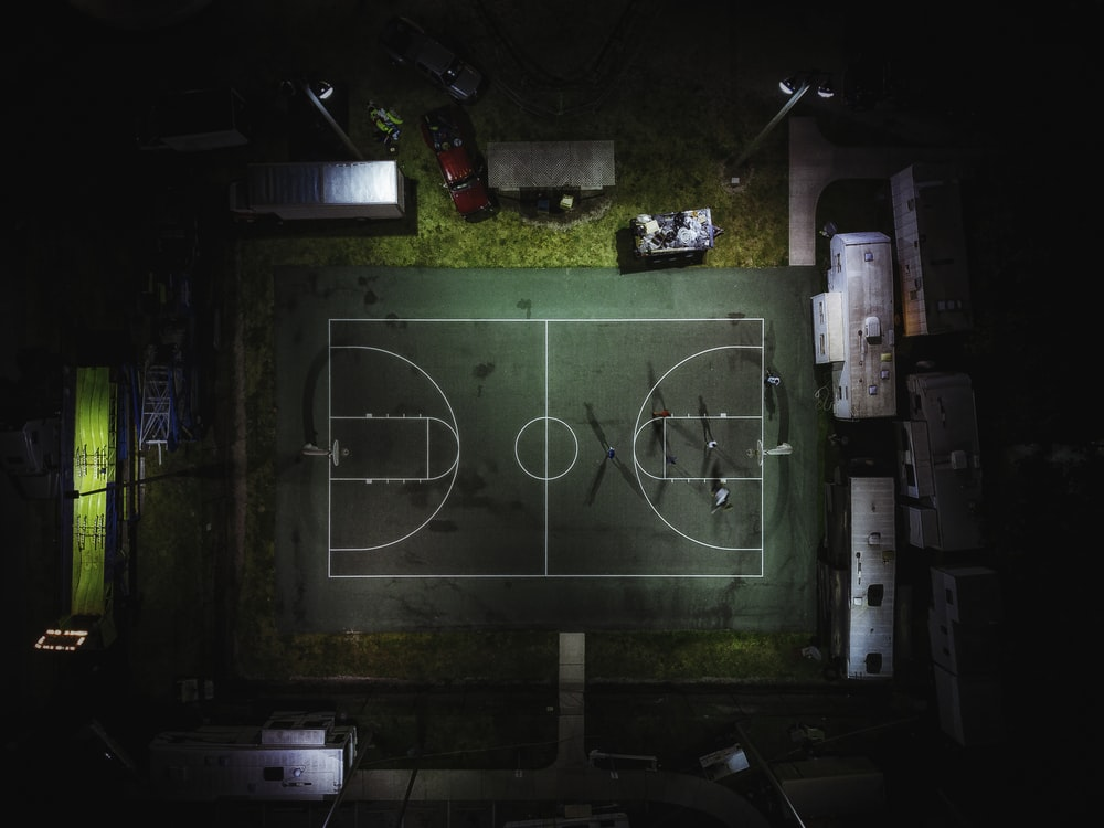aerial photography of green basketball court