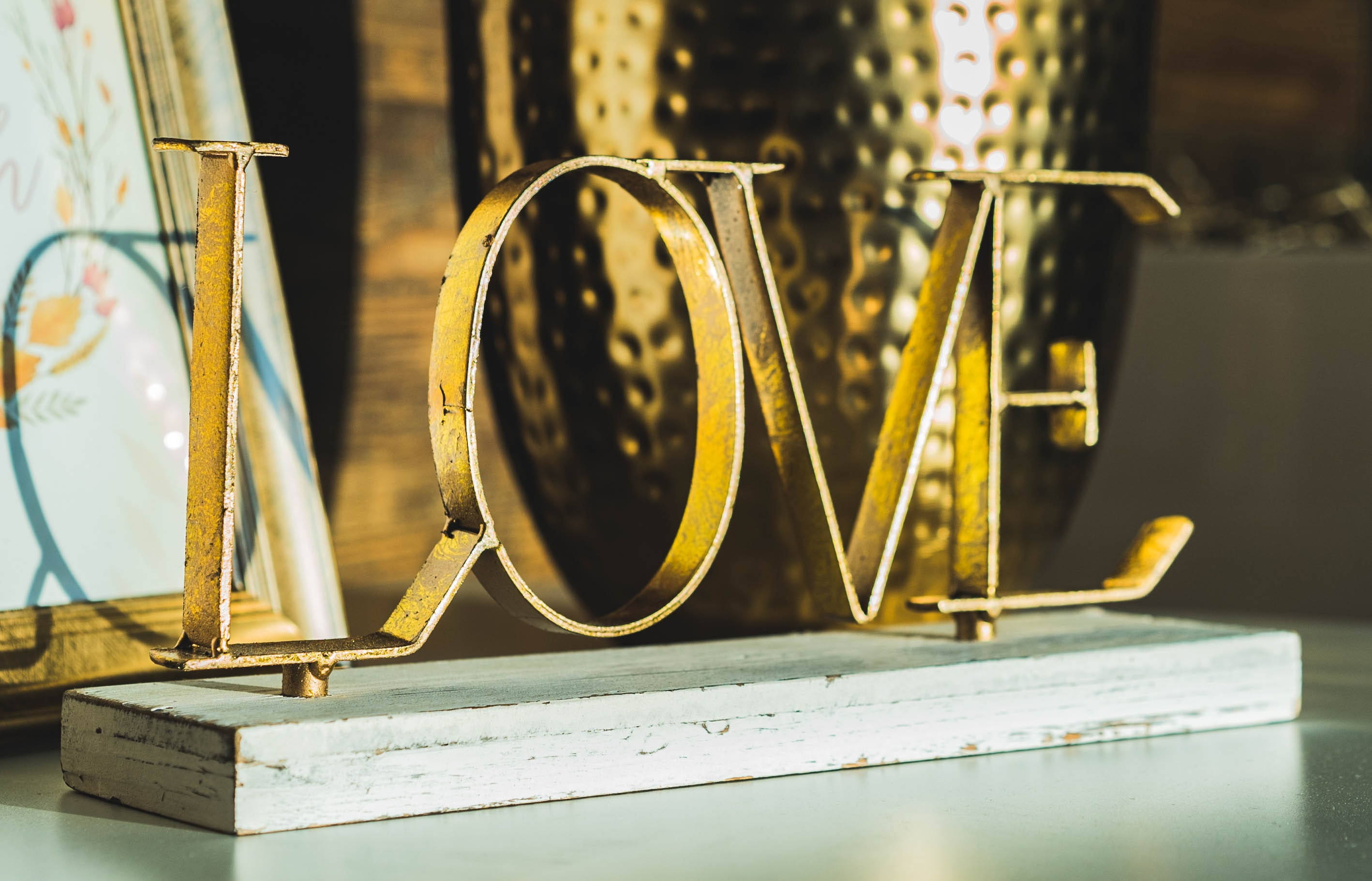 gold love freestanding letters table decor on top of white surface