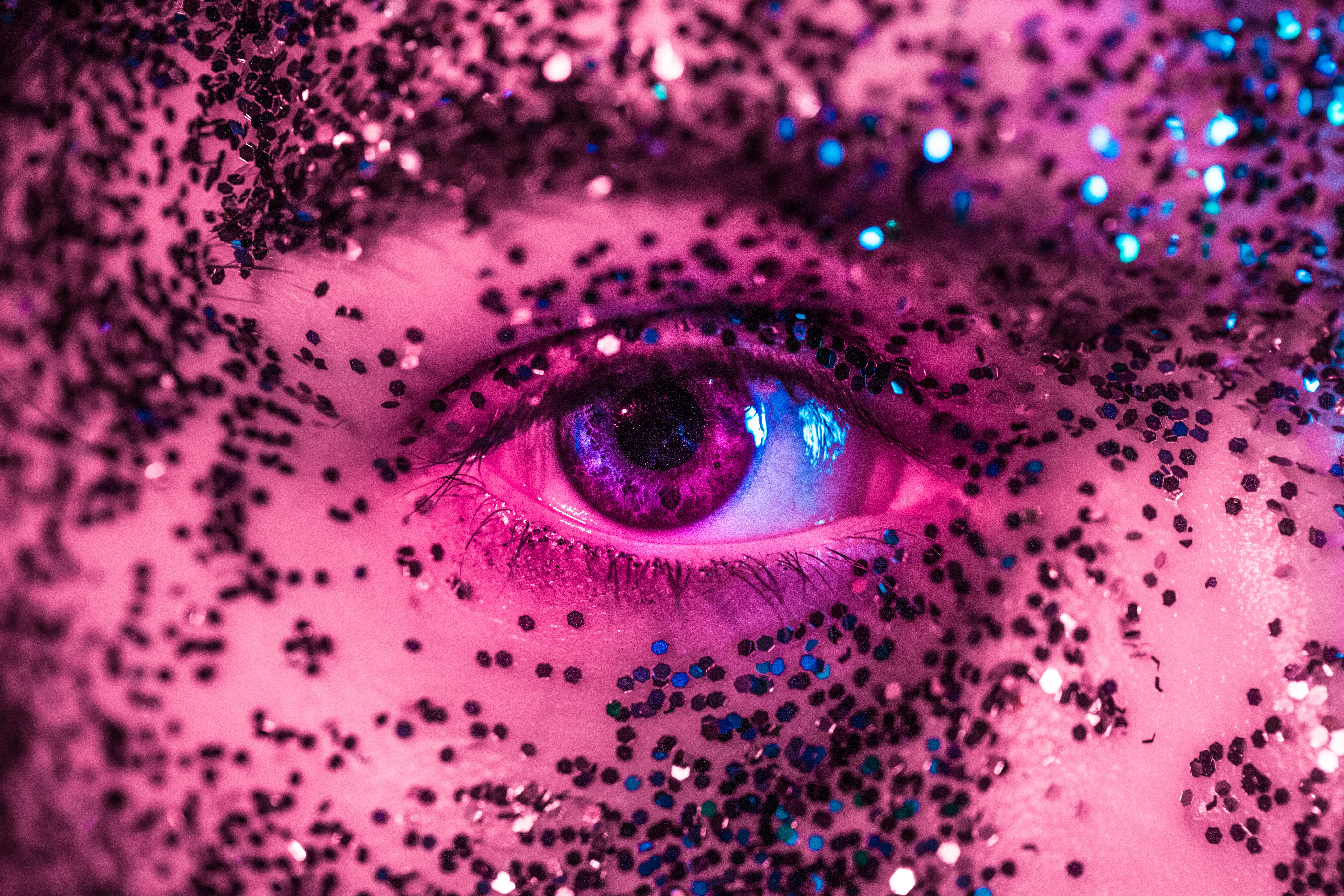 closeup photography of person's eye with glitters