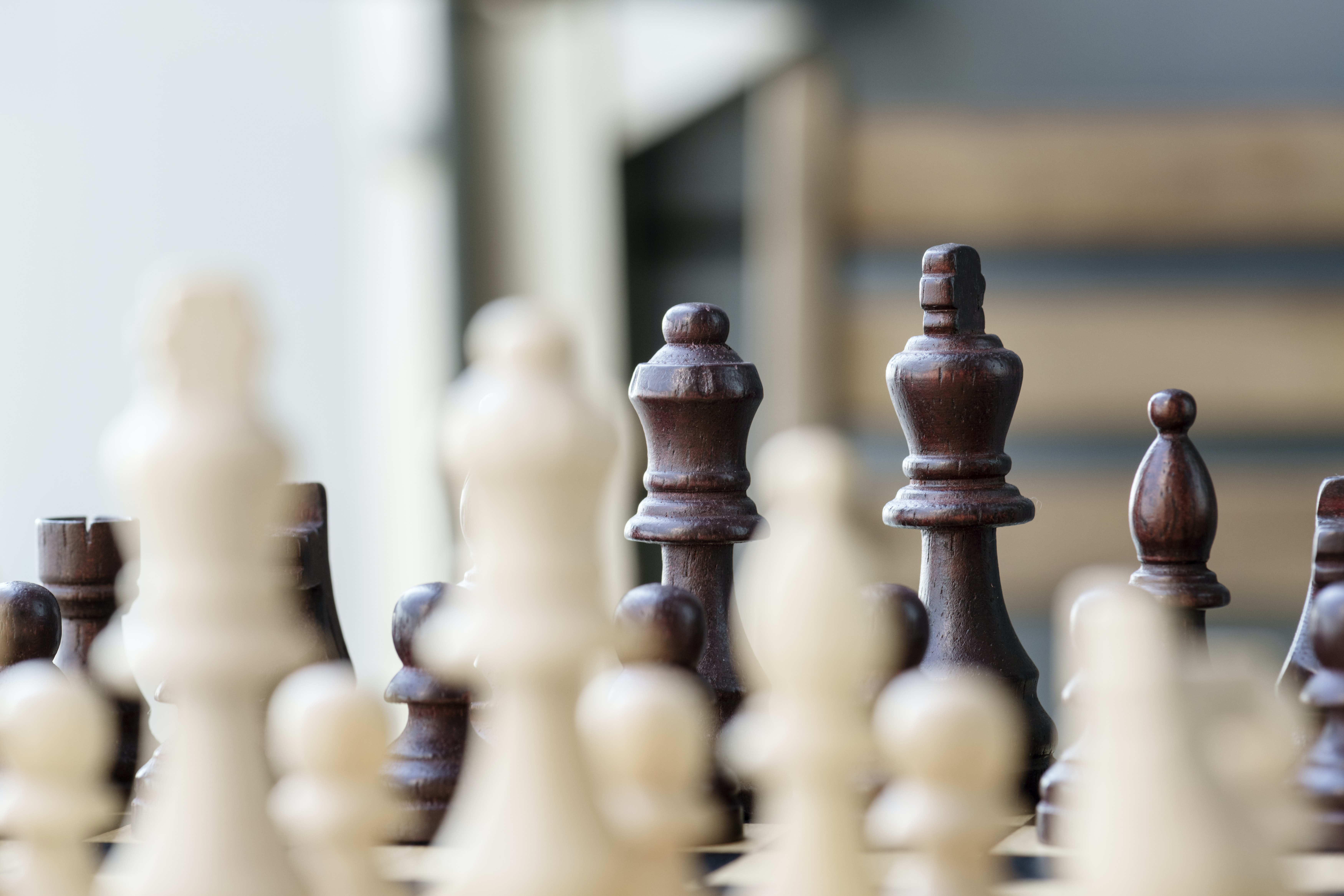 brown and beige chess pieces in focus photography at daytime