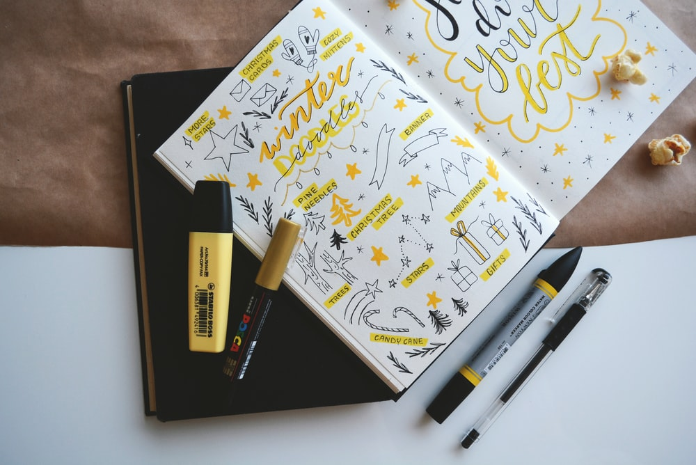 coloring book and four markers