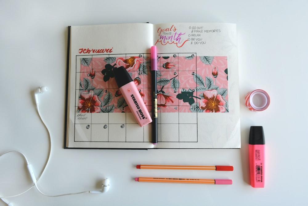 calendar notebook with highlighter pens