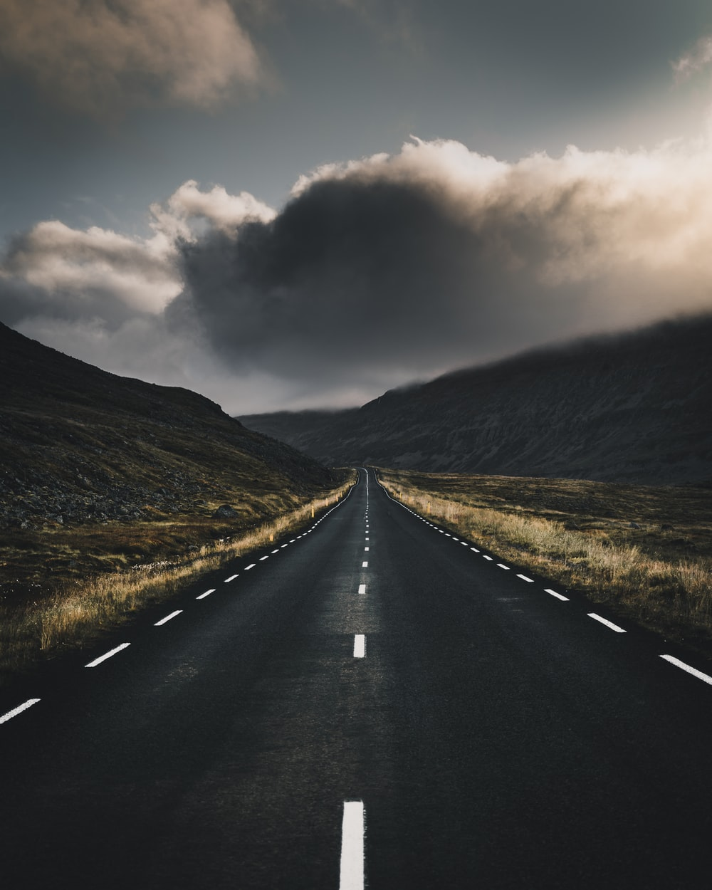 concrete road near mountain