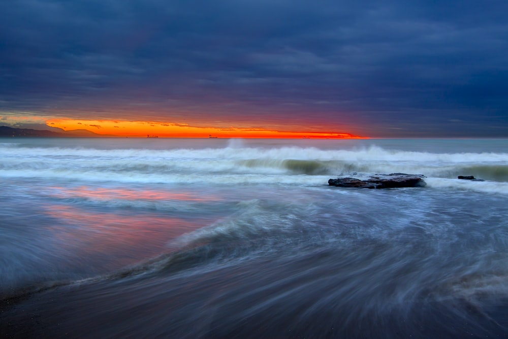timelapse panoramic photo of sea during golden hour