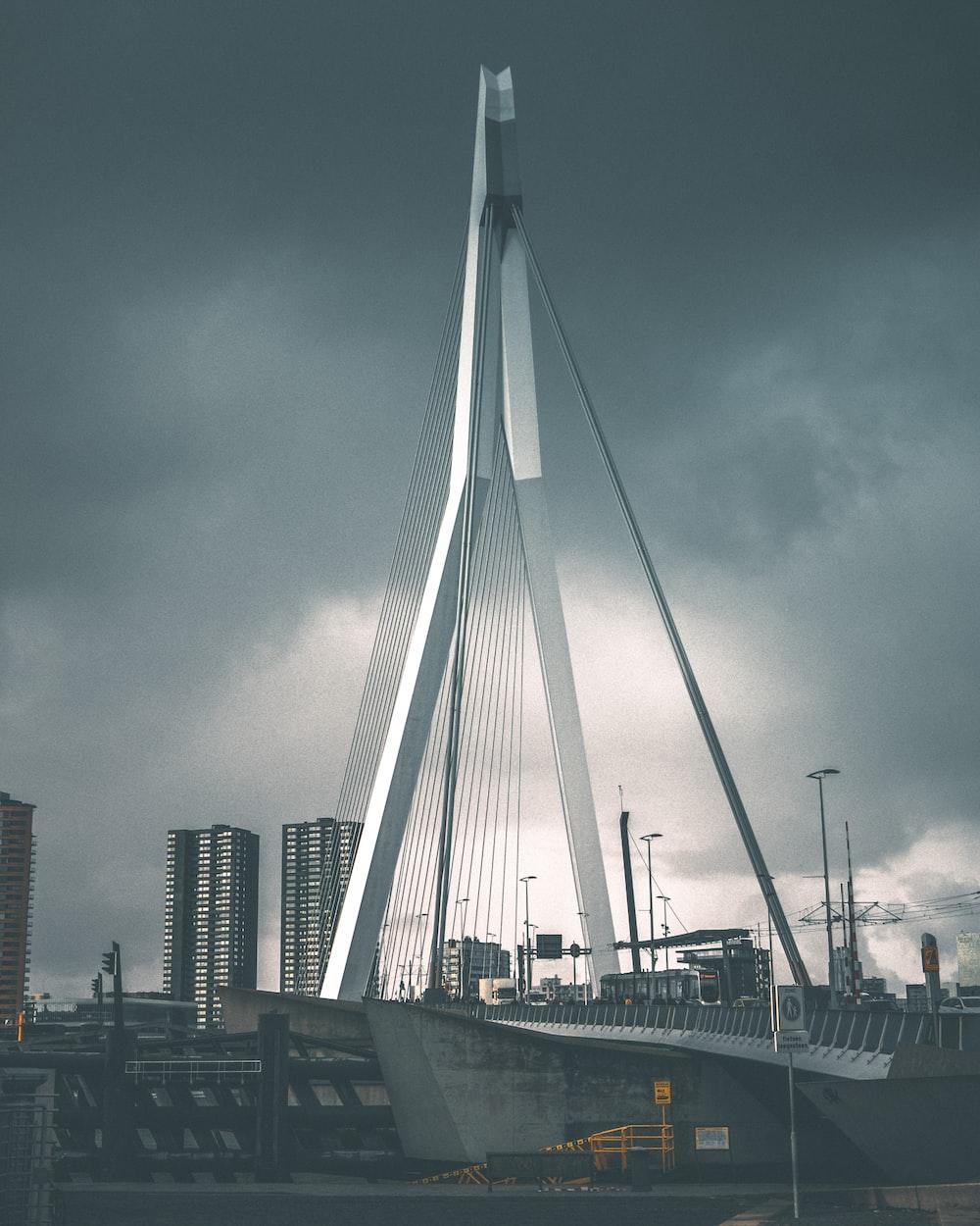 gray suspension bridge under gray clouds