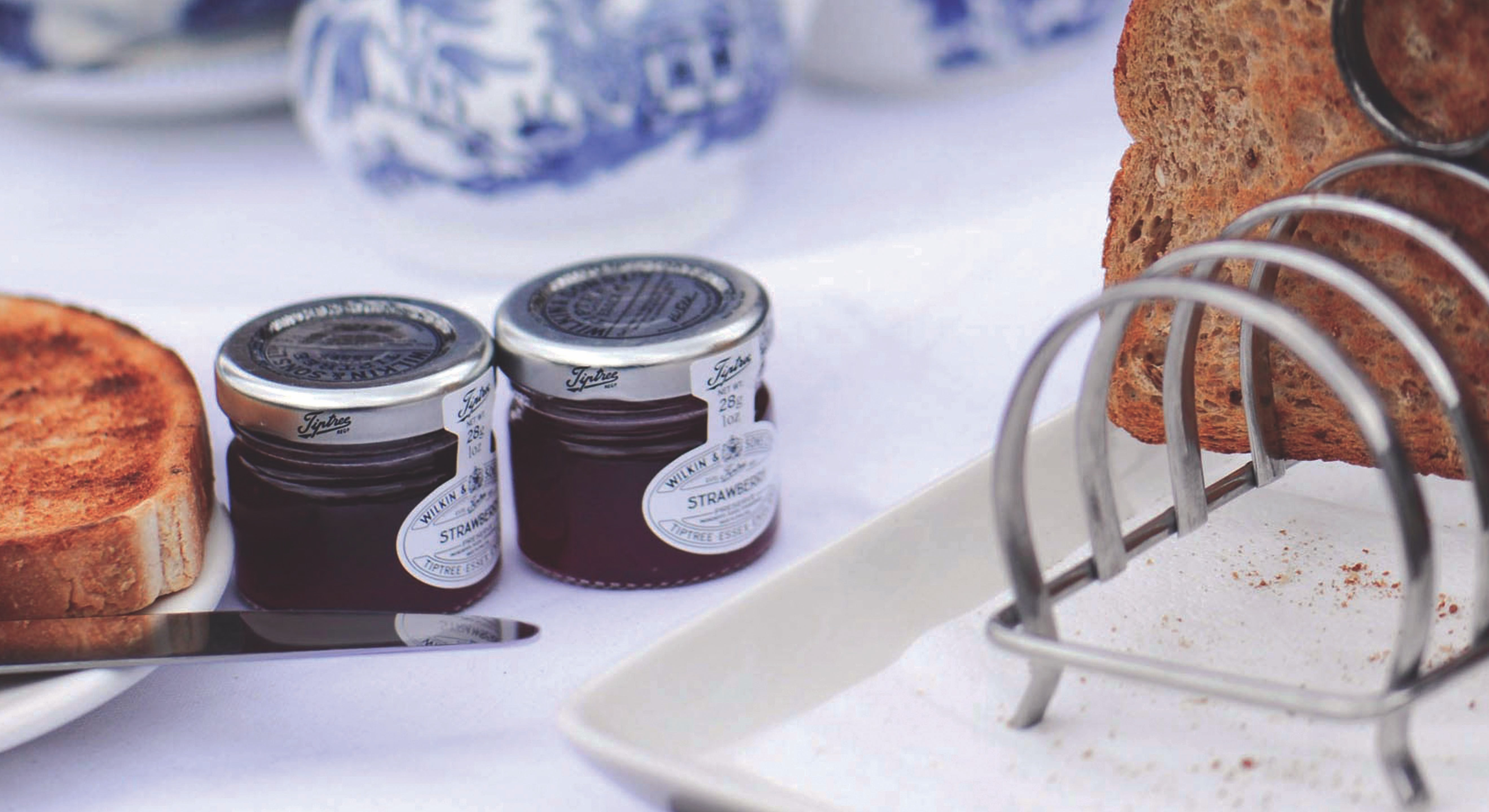 two glass jars near toasted bread