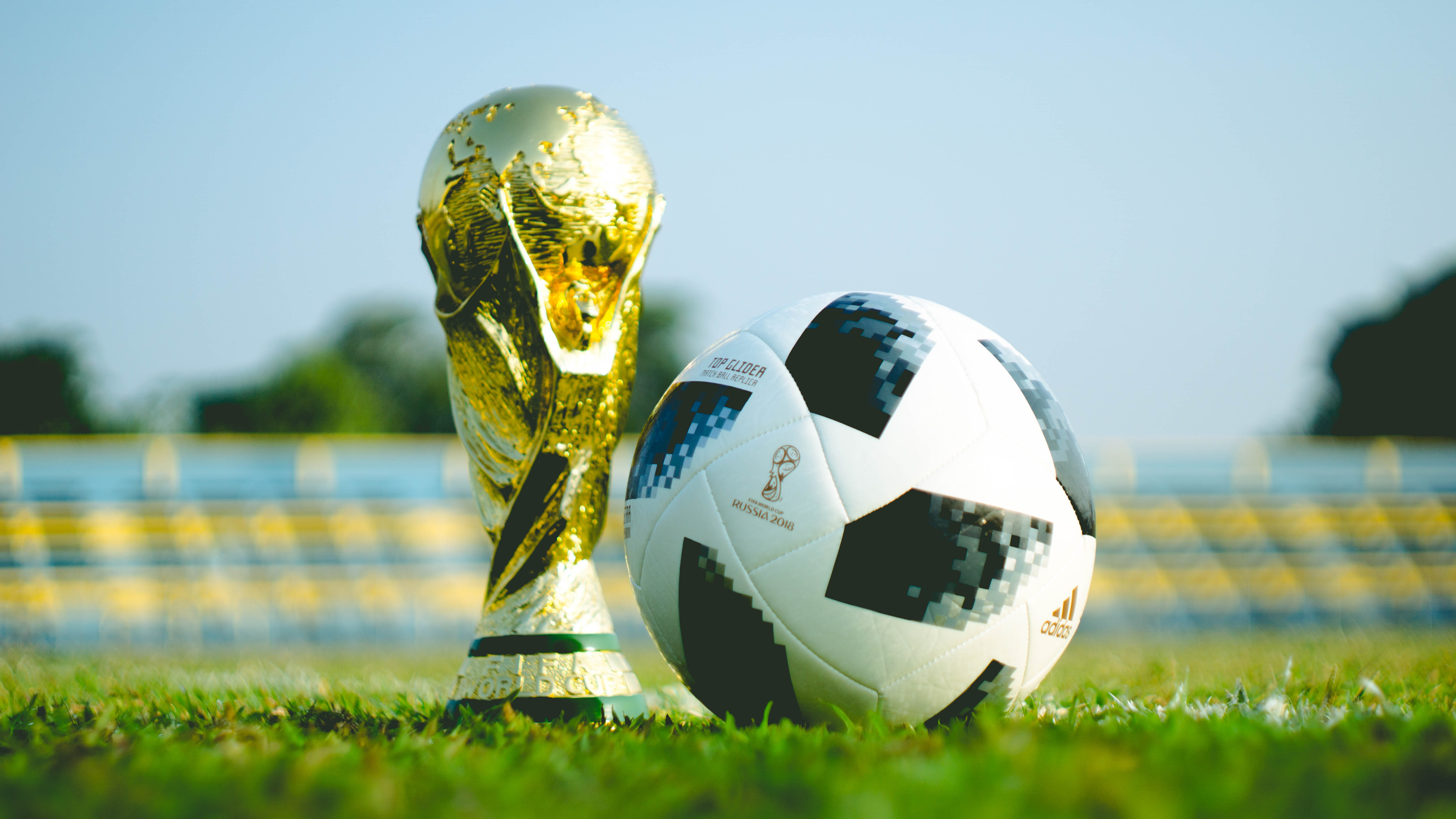 The adidas telstar 18 World Cup ball alongside the Jules Rimet trophy