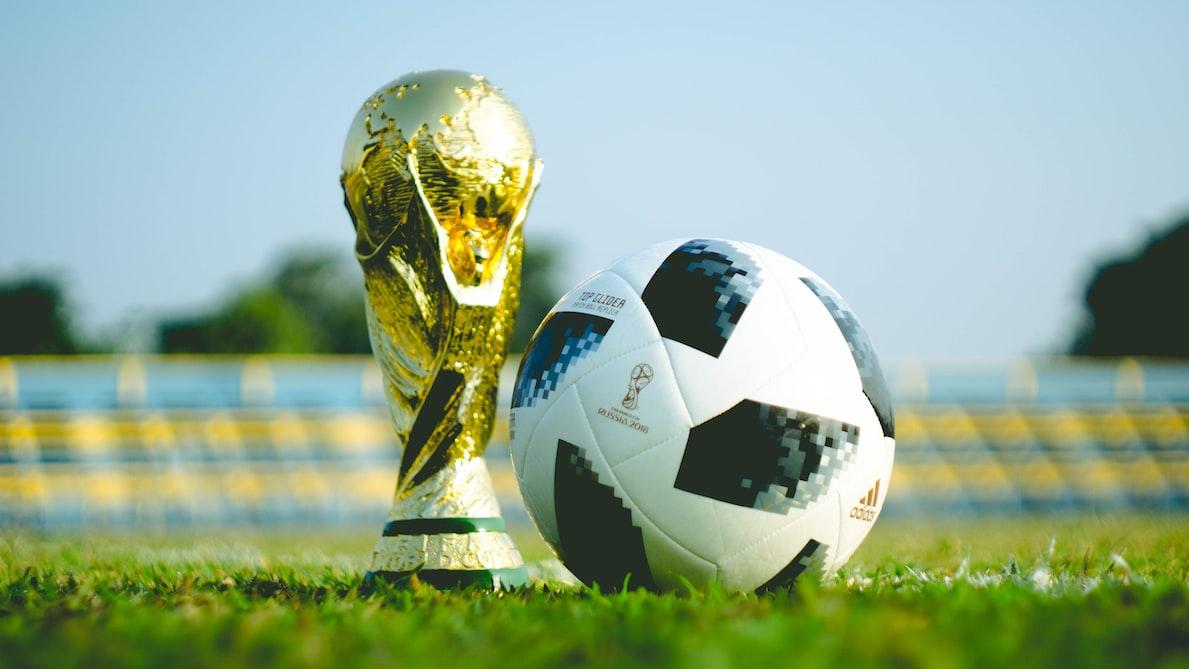 The adidas telstar 18 World Cup ball alongside the Jules Rimet trophy