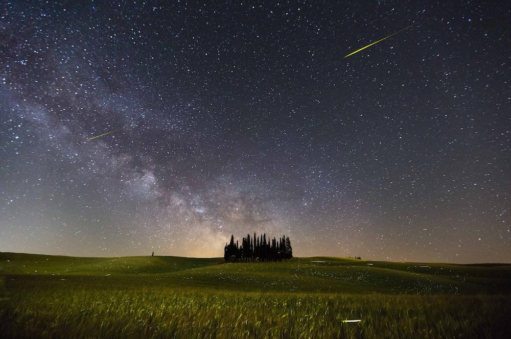 shooting star and milky way at night