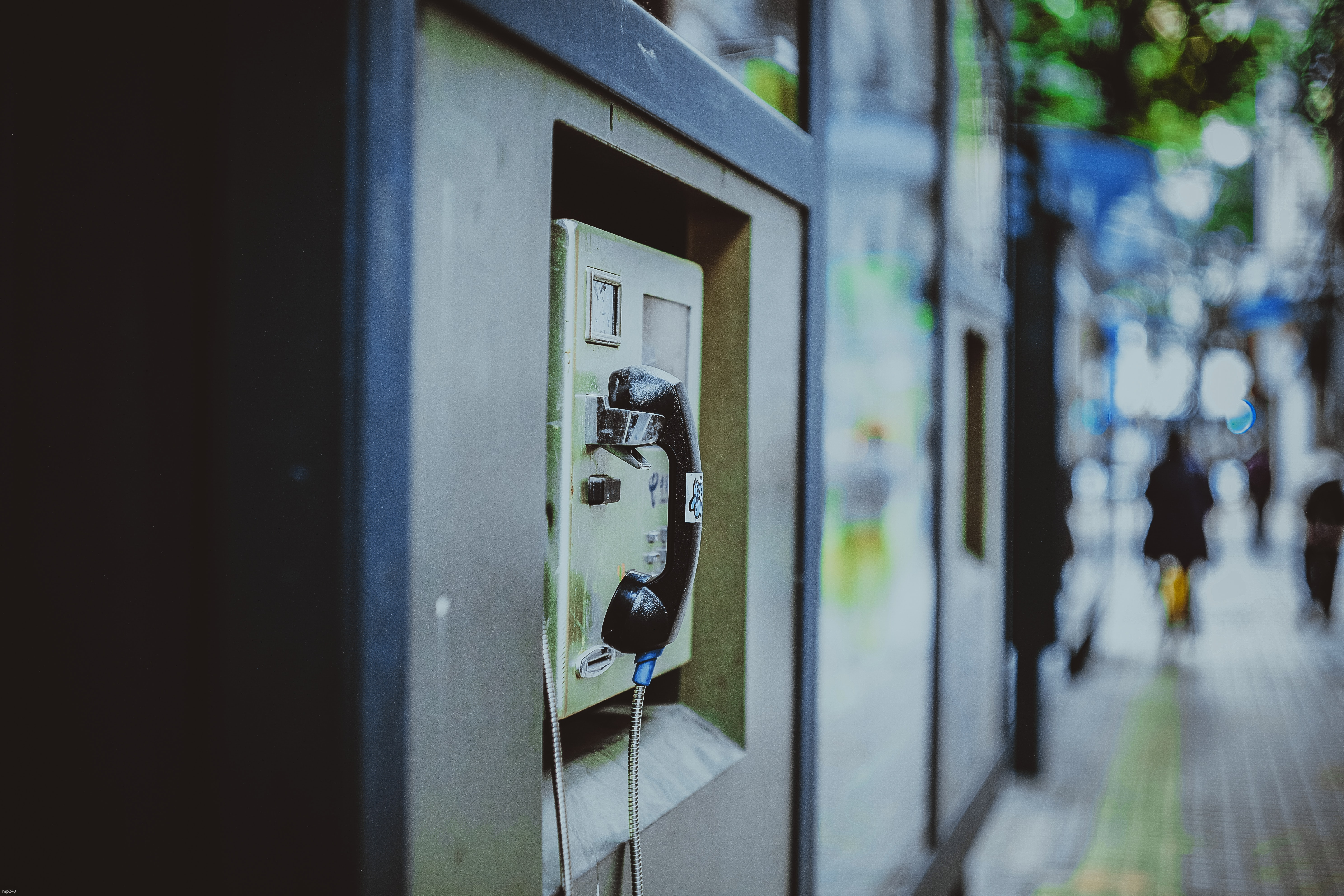selective focus photography of payphone at daytime