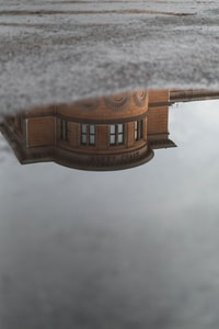 water mirror of brown commercial building