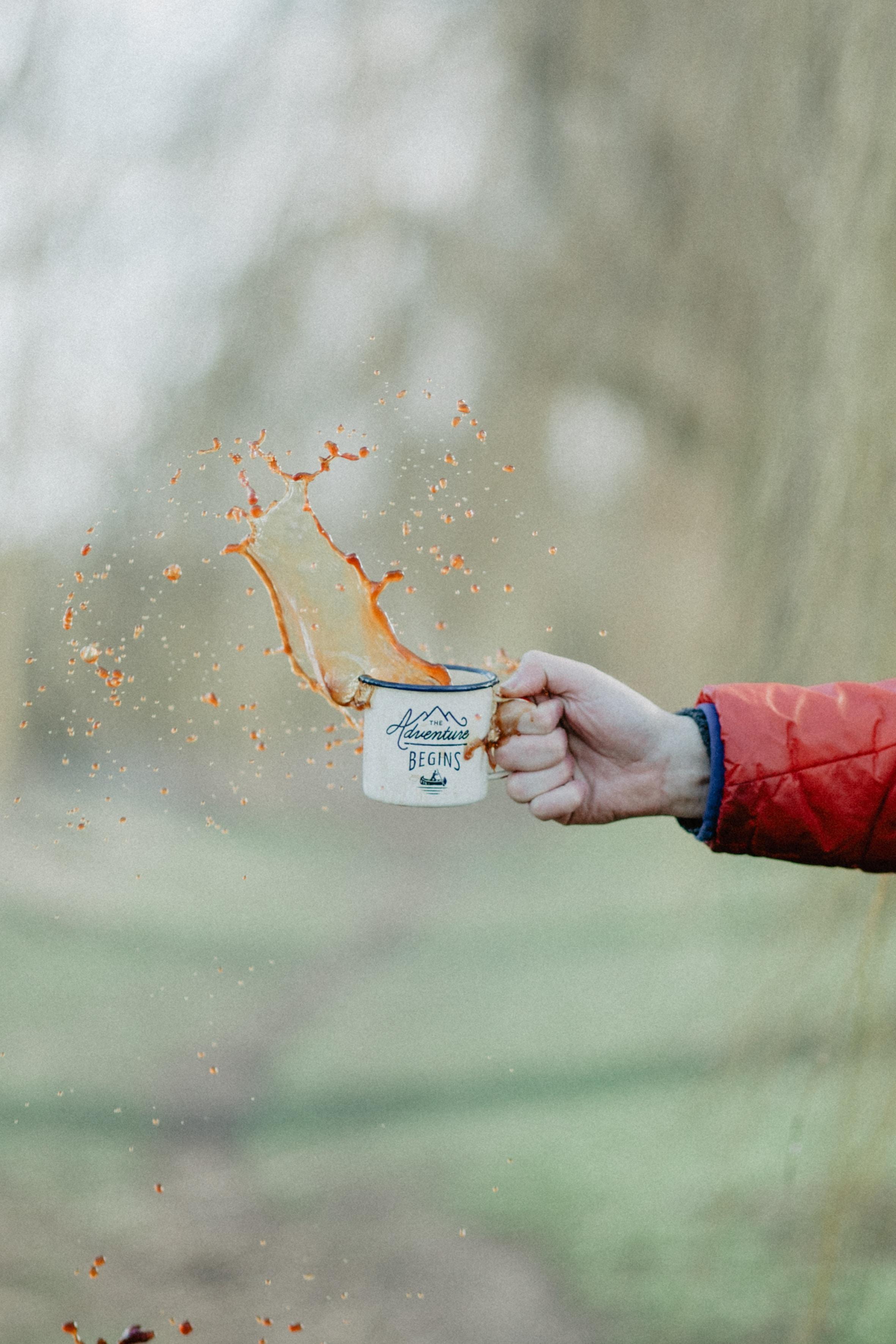 person holdign mug of coffee