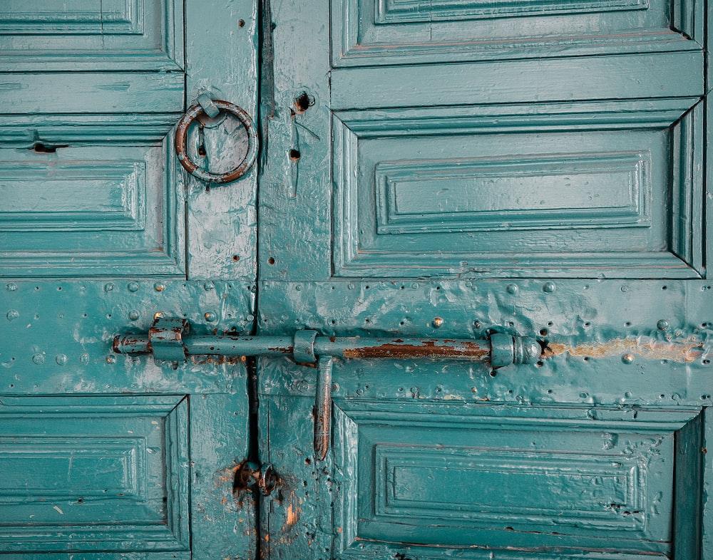 close-up photography of teal door