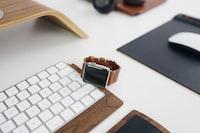 silver aluminum case Apple Watch on Apple Magic keyboard