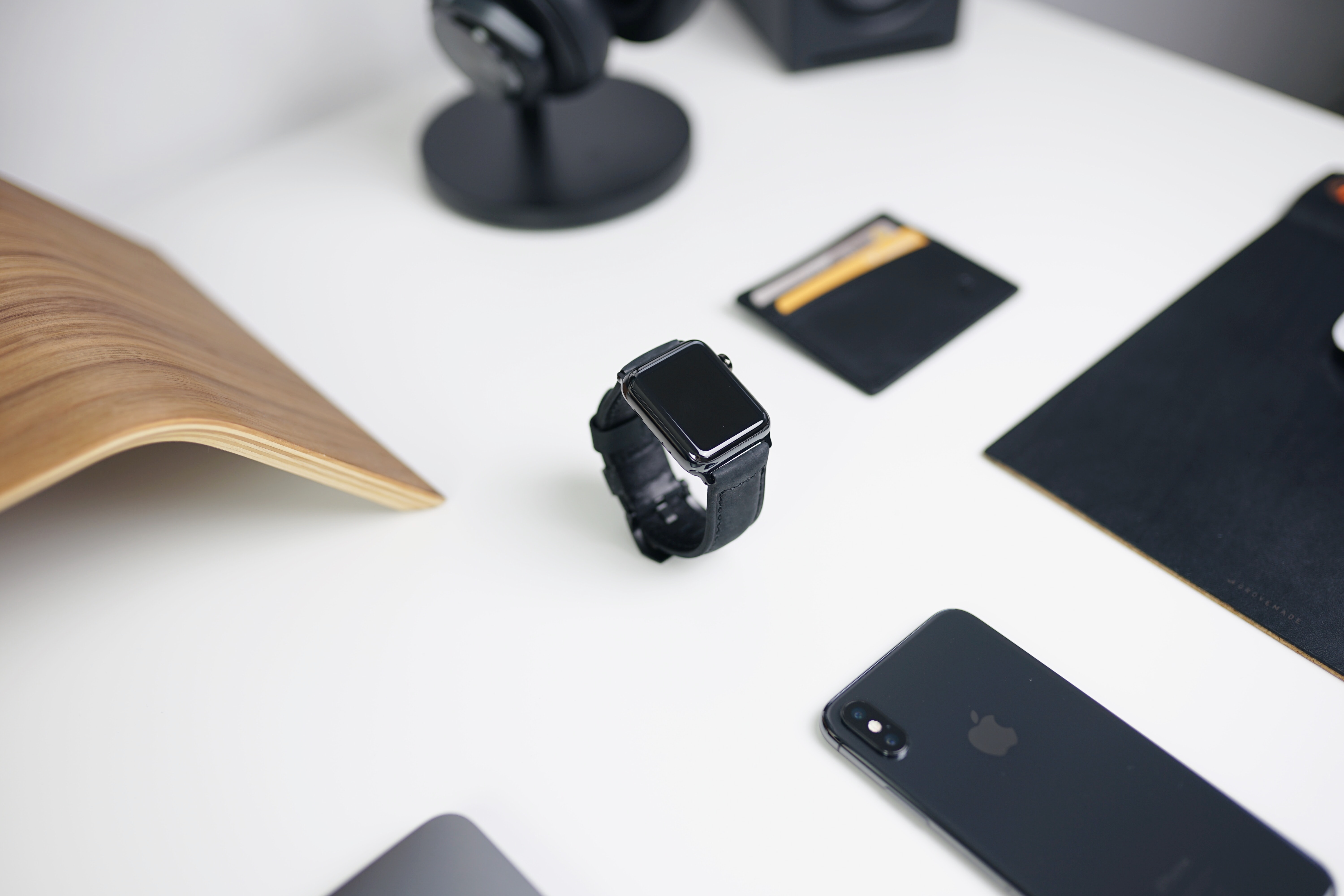 black smartwatch on table near iPhone
