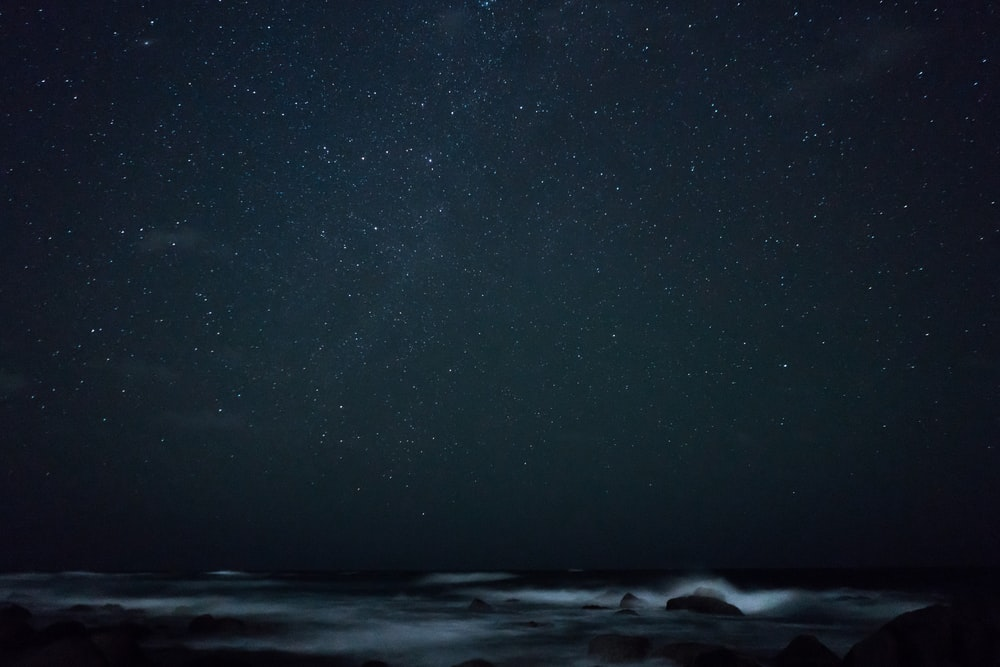 sea waves under starry night