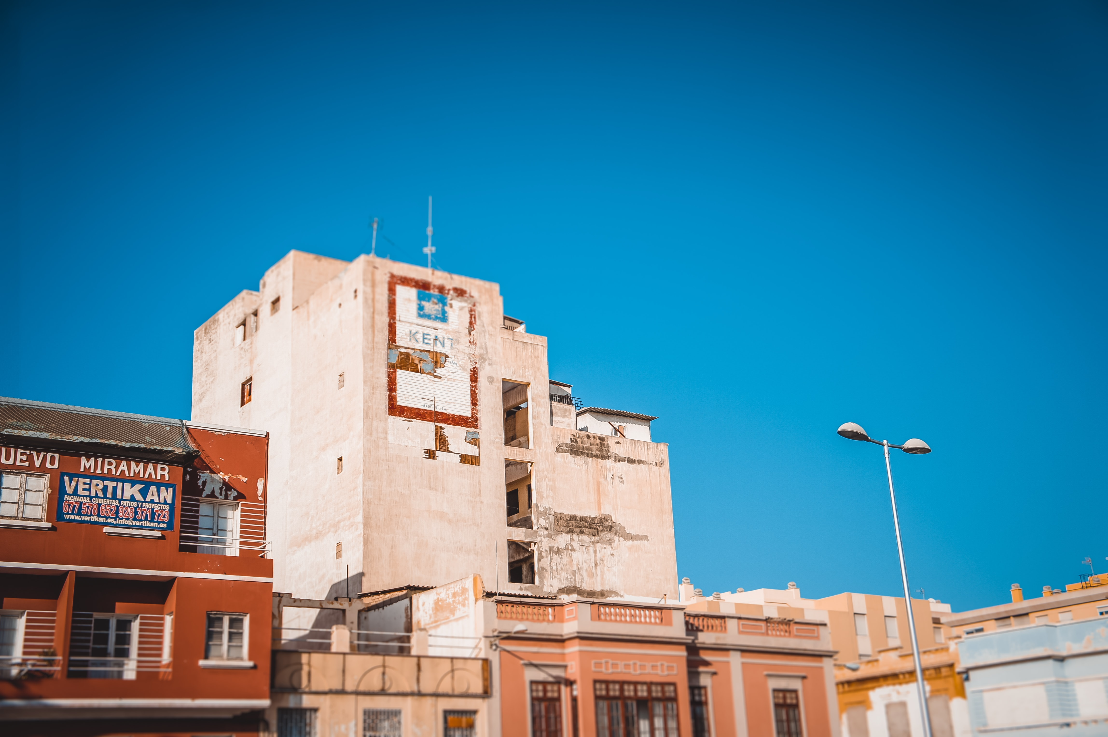 brown and white concrete buildings under blue sky at daytime