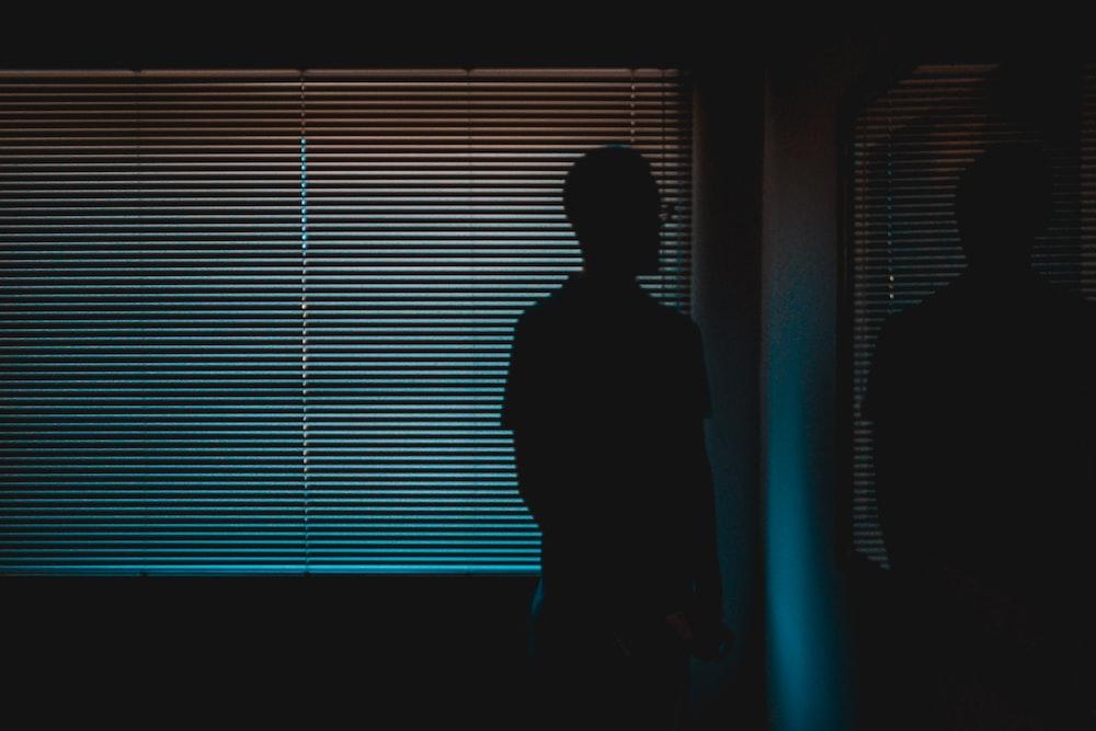 silhouette of man near window