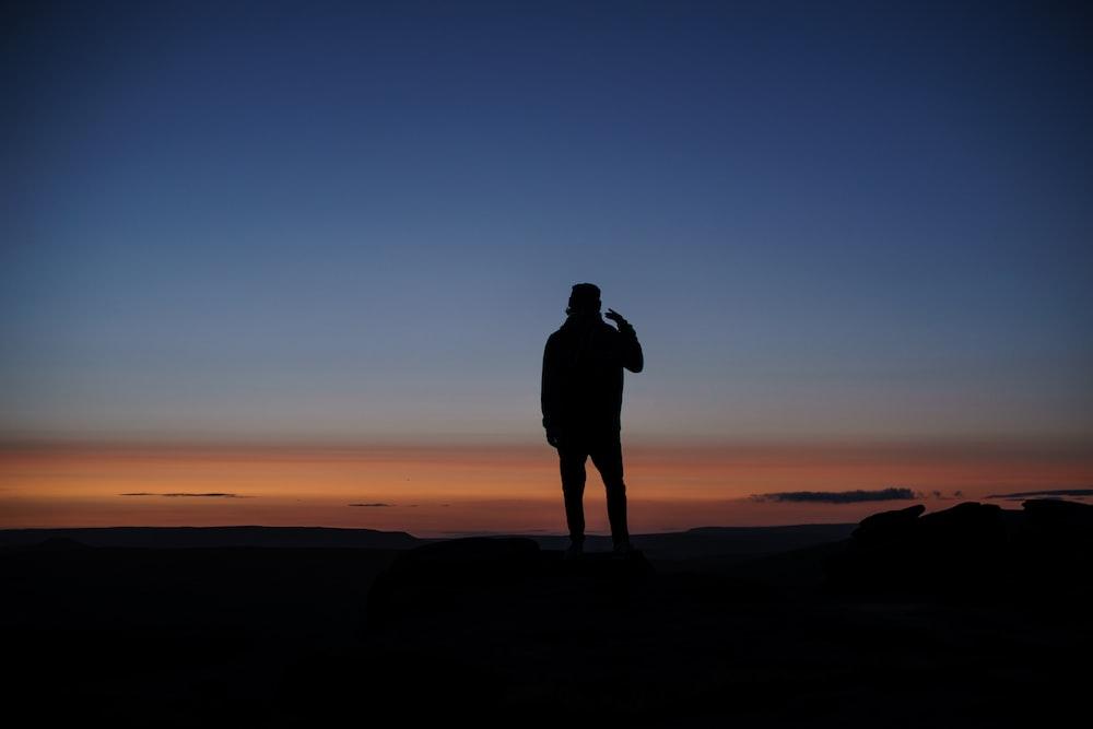 man standing on ground photo