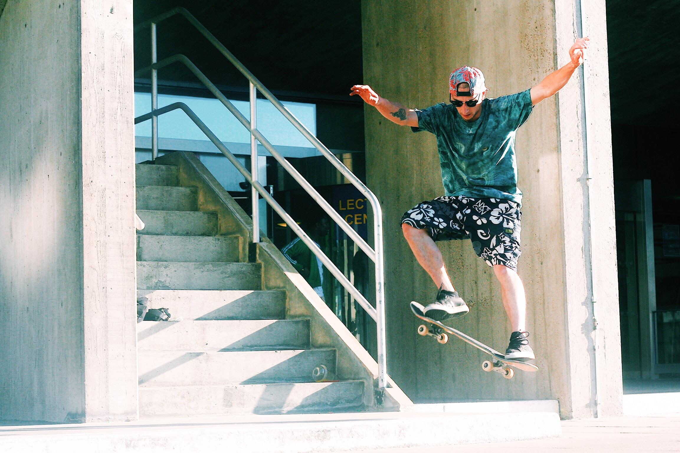 man skateboarding near stairs during daytime