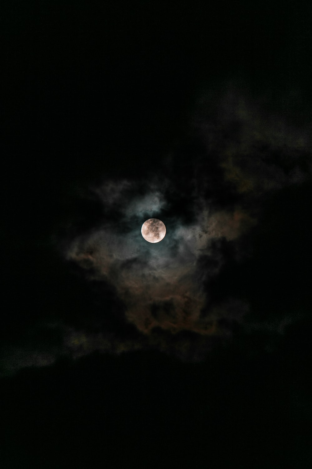 moon covered with clouds at nighttime