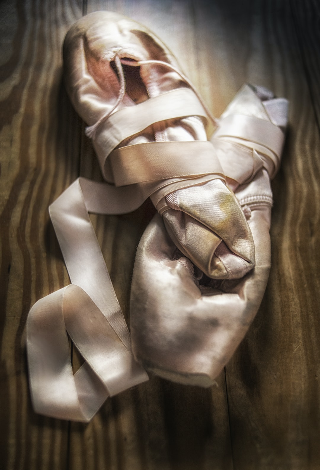 My wife was a professional dancer. When age told her no more, I photographed the last pair of pointe shoes she had worn. They are a bittersweet reminder of a life in the pursuit of excellence. Simple window light seemed appropriate.