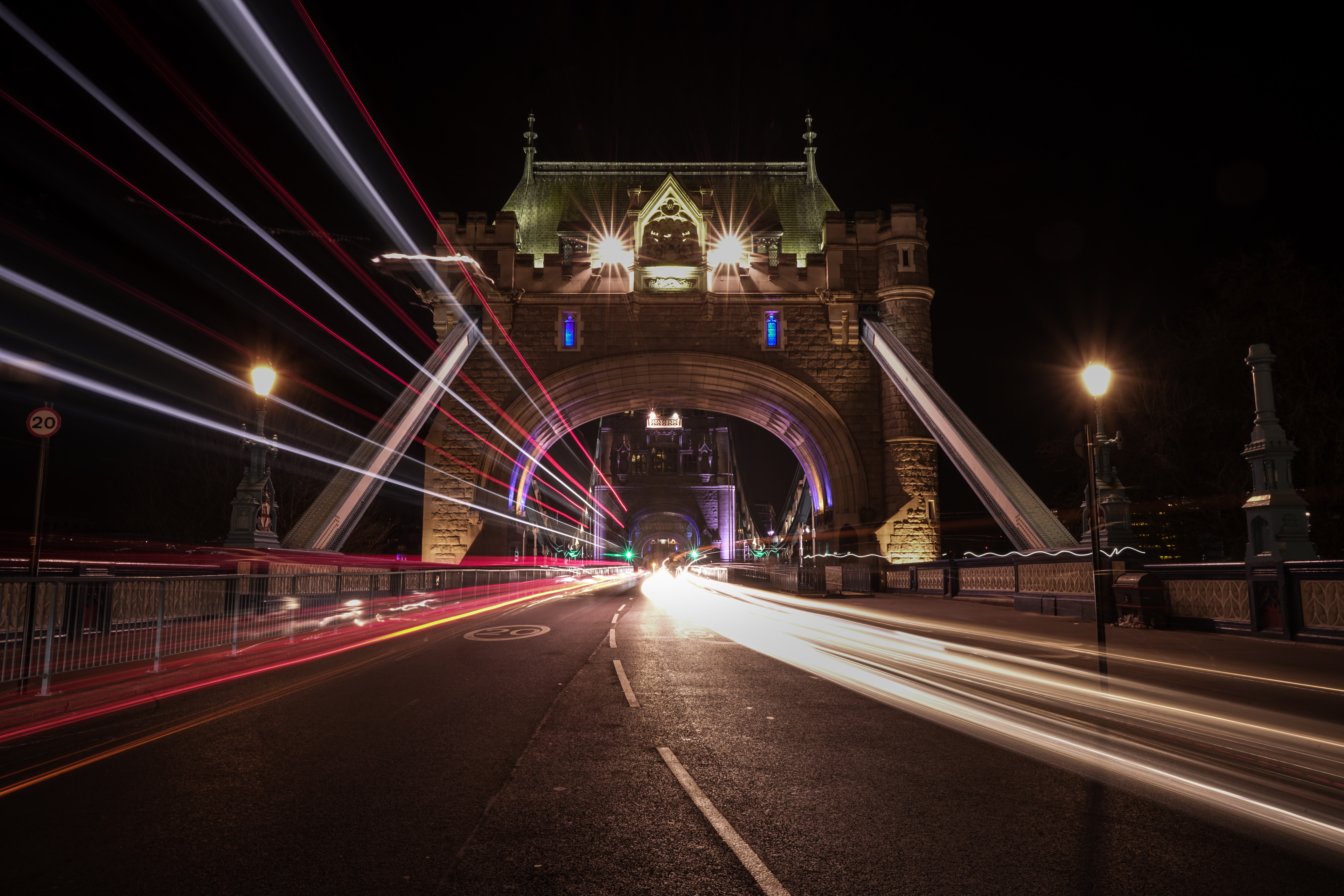 time lapse photography of suspension bridge at nighttime
