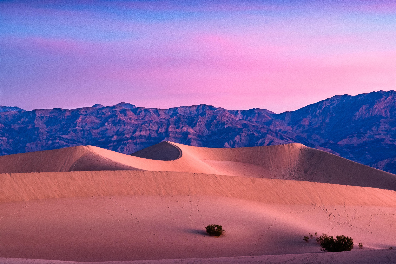 desert mountain under cloudy skies