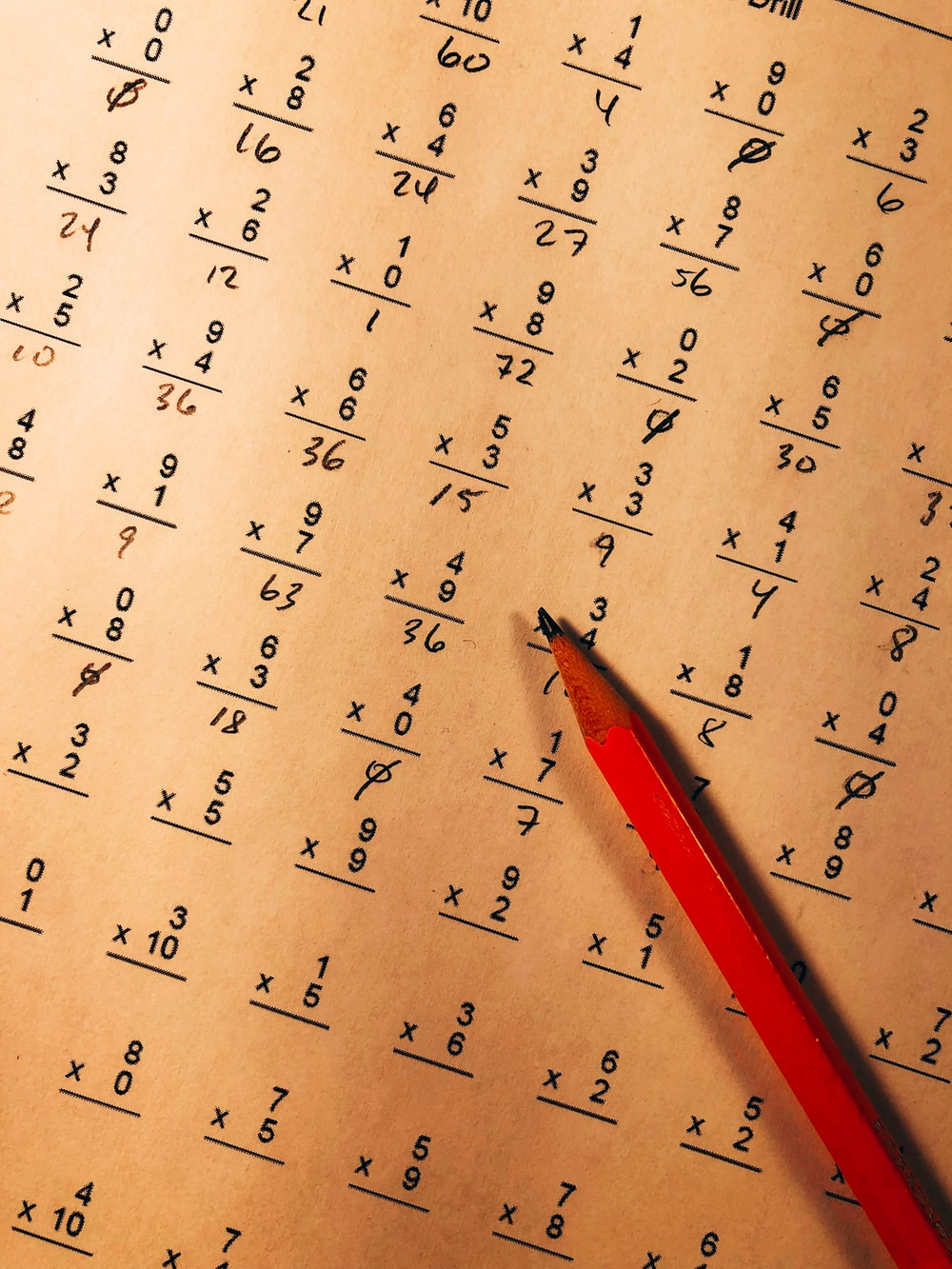 red pencil on top of mathematical quiz paper